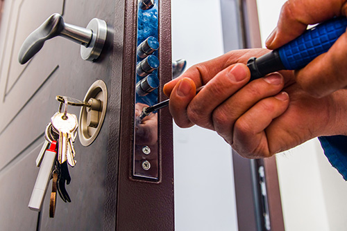 Your Voice Link - Locksmith unlocking a lock